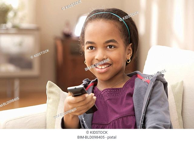African American girl watching television