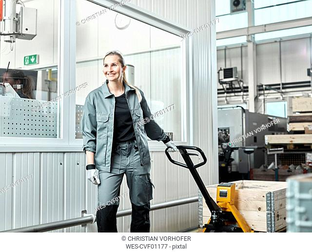 Industry, woman using pallet jack