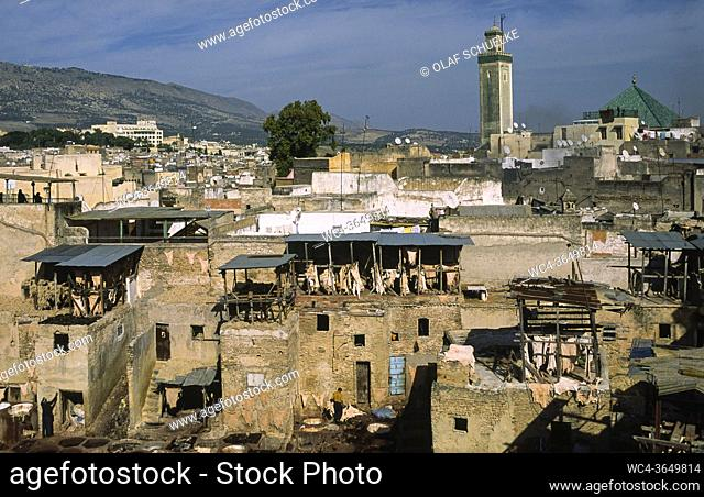 Fes, Morocco, Africa - Elevated view over the roofs of a traditional tannery and dye factory in the walled medina with its historic buildings of the old city