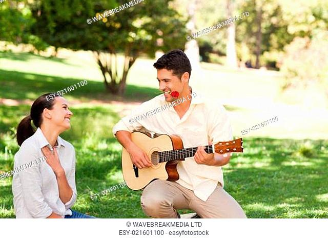 Man playing guitar for his girlfriend