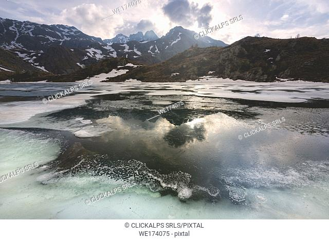 Seroti lake at thaw in Stelvio national park, Lombardy district, Brescia province Italy