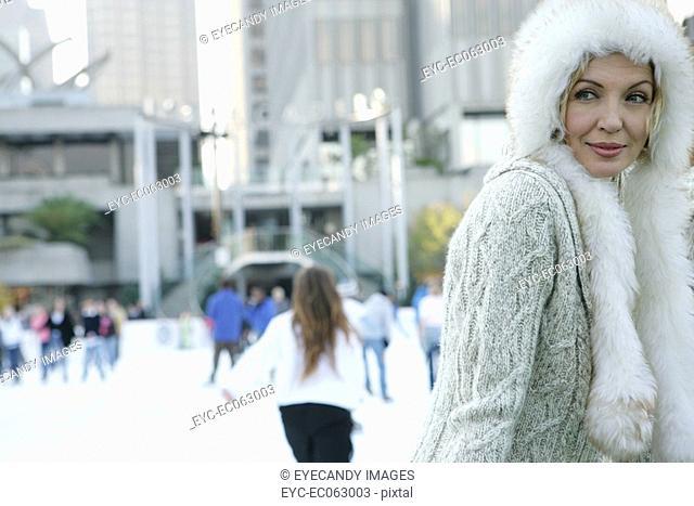 Mature woman wearing a fur hat