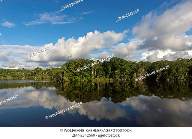 Clouds reflecting in Garzacocha Lake, a lagoon in the rain forest at La Selva Lodge near Coca, Ecuador