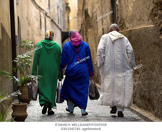 Men and women walking on street in Fez, Morocco