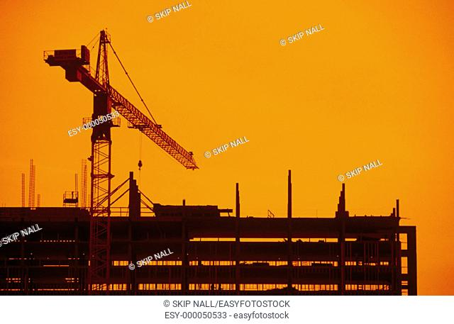Building construction with crane in the background