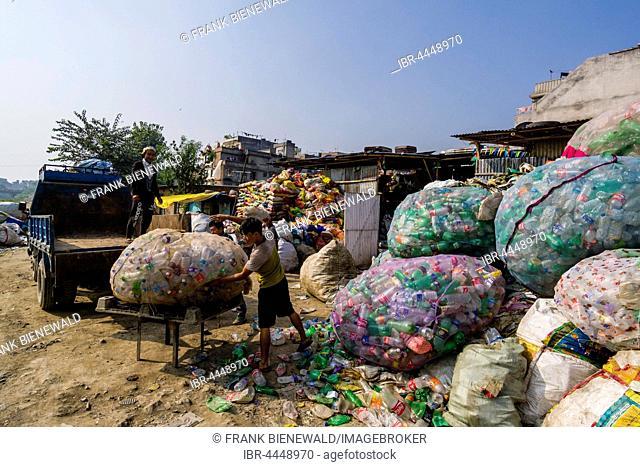 People collecting empty plastic bottles, Kathmandu, Nepal