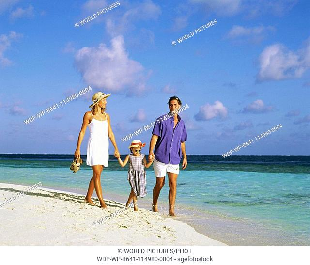 Family on the beach , Maldives Date: 10 06 2008 Ref: WP-B641-114980-0004 COMPULSORY CREDIT: World Pictures/Photoshot