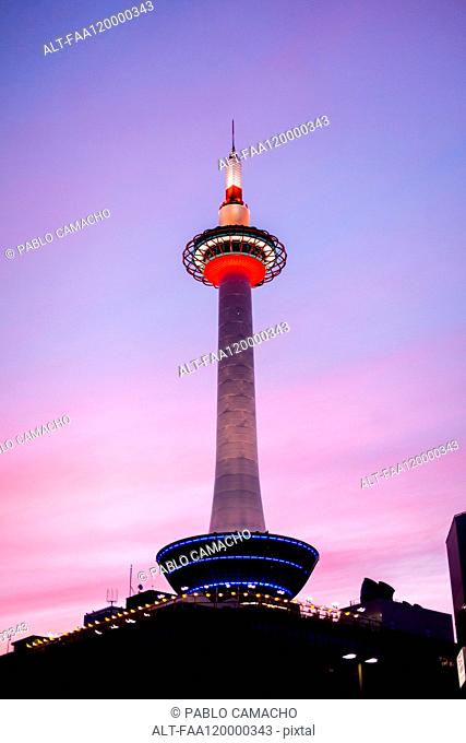 View of Kyoto Tower against blue sky