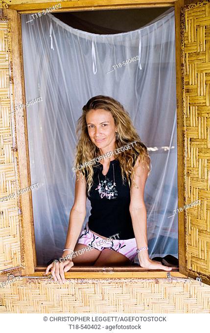 girl posing on plaited bamboo window