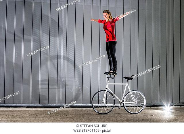 Young woman doing artistic cycling