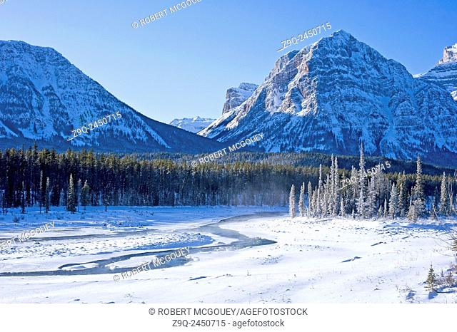 A Rocky mountain winter scenic along the freezing Athabasca river in Jasper National Park, Alberta, Canada