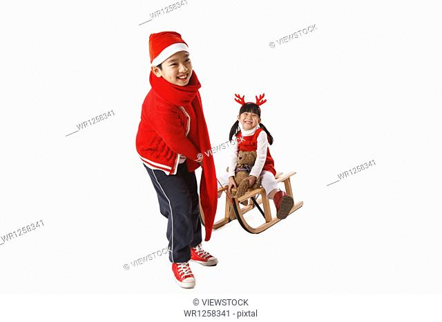 Children playing sled at Christmas