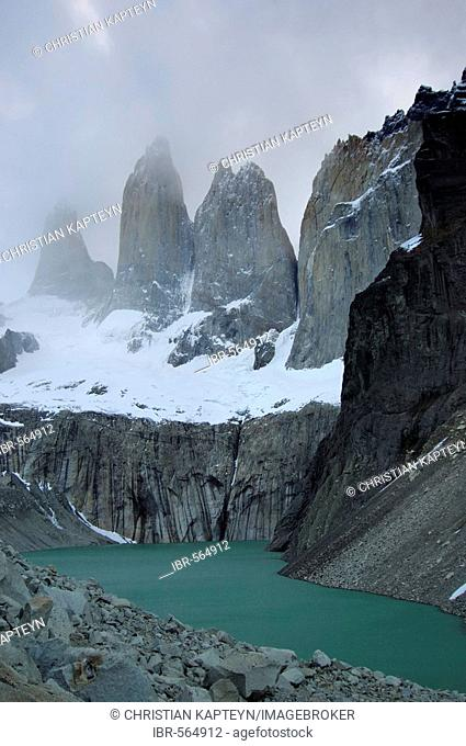 Three rock towers in the clouds, Torres del Paine National Park, Patagonia, Chile (Torres del Peine)