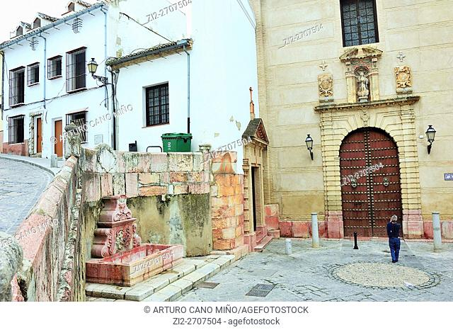 Fountain and church in the Historical Downtown. Antequera, Málaga province, Spain