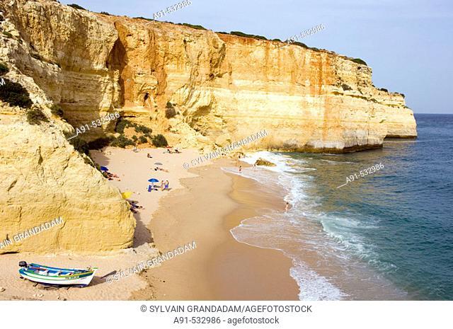 Small beach and fishermen harbour on the coast near Albufeira. Algarve. Portugal