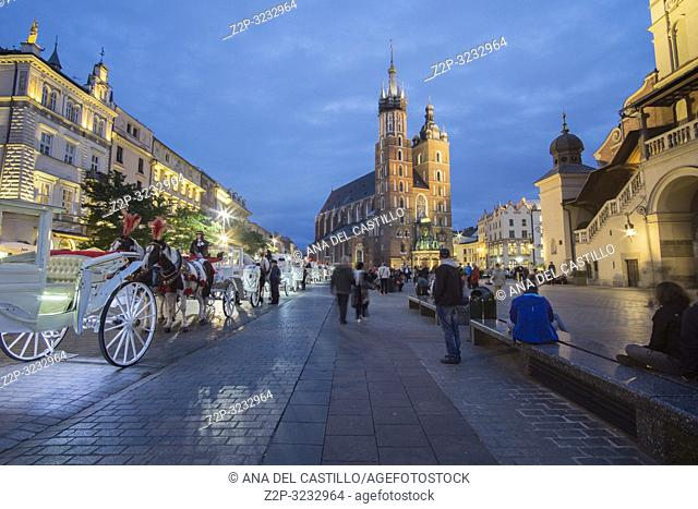 KRAKOW POLAND ON SEPTEMBER 23, 2018: The largest medieval european town square - the market square in Krakow with gothic St. Mary's church, Poland