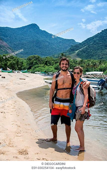 Couple in love traveling through Ilhabela Island, Sao Paulo, Brazil. Beautiful Adventure