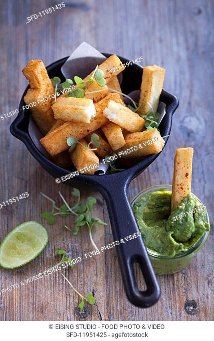 Deep fried halloumi sticks with avocado cream