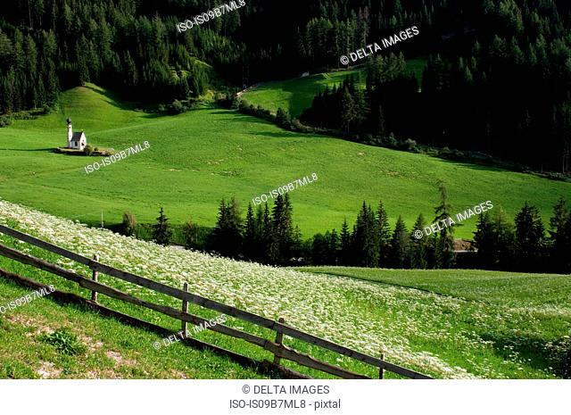 View of distant valley and St. Johann Church, Funes Valley, Dolomites, Italy