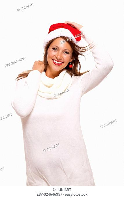 Young woman in a Santa hat holding out her hands with her empty palms upwards for placement of your Christmas and seasonal products