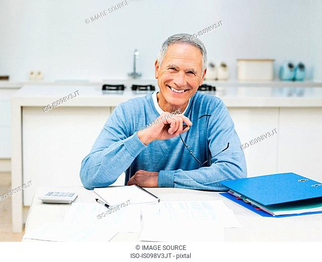 Senior man doing home finances