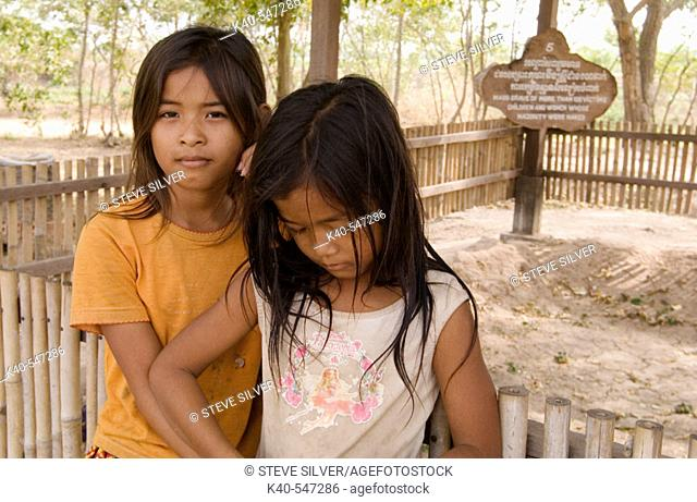 Children among the Killing Fields of Choeung Ek. Between 1975 and 1978 about 17, 000 women, men, and children were transported to this extermination camp by the...