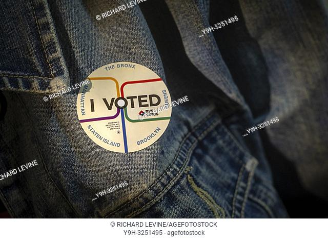 """A voter wears her """"I Voted"""" sticker on Election Day in New York on Tuesday, November 6, 2018"""