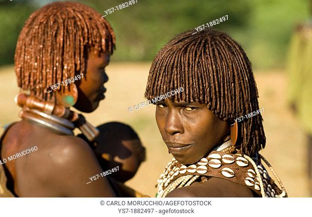 Two young Hamer women in their little village near Arbore, Lower valley of the Omo, Ethiopia, Africa