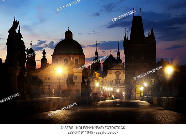 Morning illumination on Charles bridge in Prague