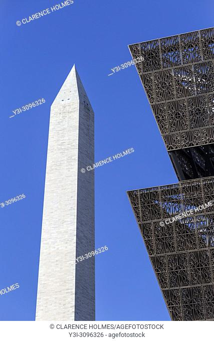 The angular metal architecture of the Smithsonian National Museum of African American History and Culture contrasts with the stone structure of the Washington...