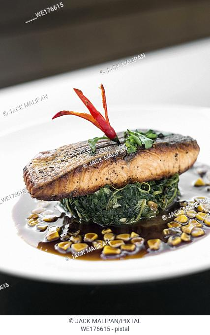 salmon fillet with steamed spinach and corn with sweet soy and oyster sauce