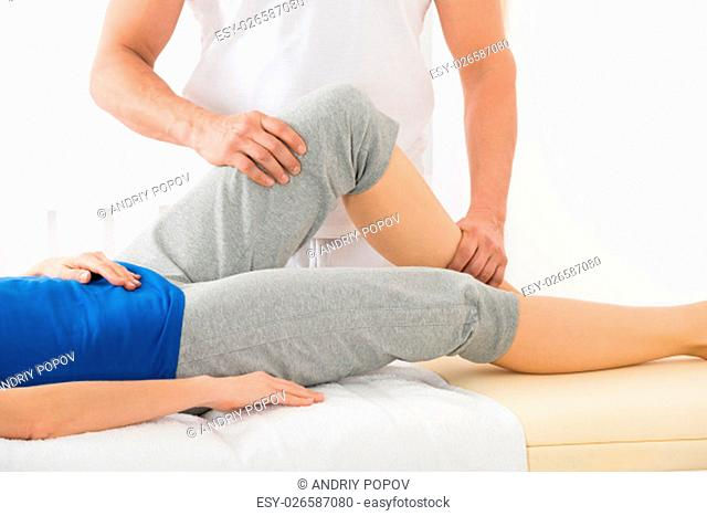 Close-up Of Therapist Hand Doing Knee Massage In Spa Saloon