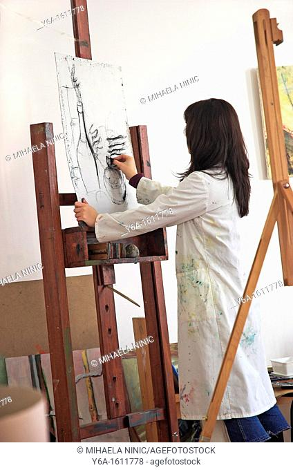 Young female art student drawing