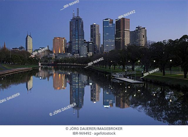 Skyline of Melbourne and its reflection in the Yarra River before sunrise, Victoria, Australia