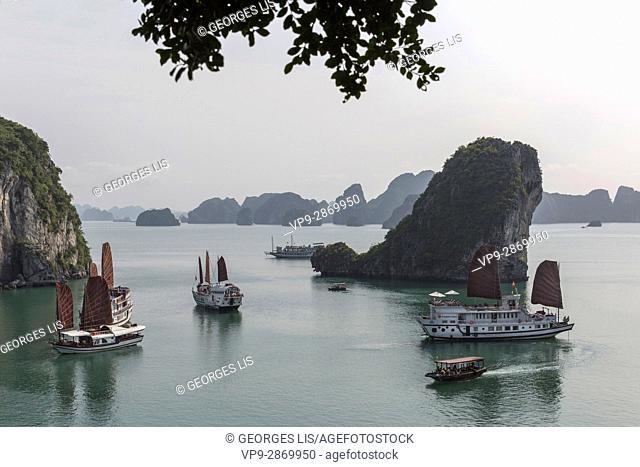 Ha Long Bay skyline rocks boulders with cruise boat junk Vietnam
