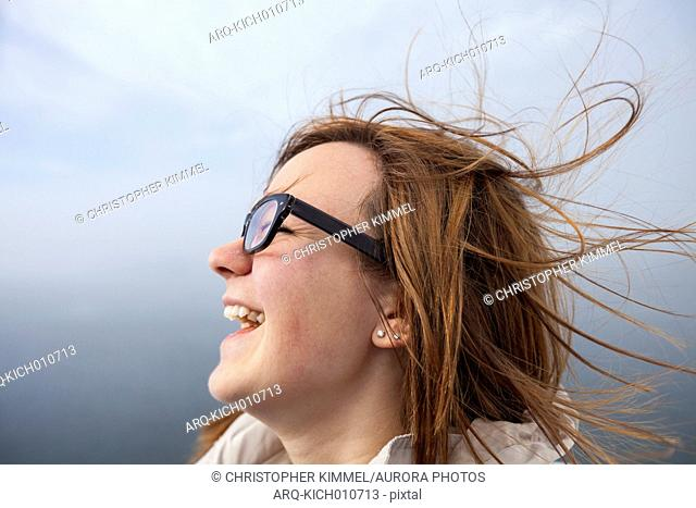 Portrait of a woman laughing outdoors