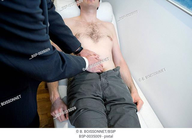 ABDOMEN SEMIOLOGY, MAN Model and doctor. Consultation in a cardiology office