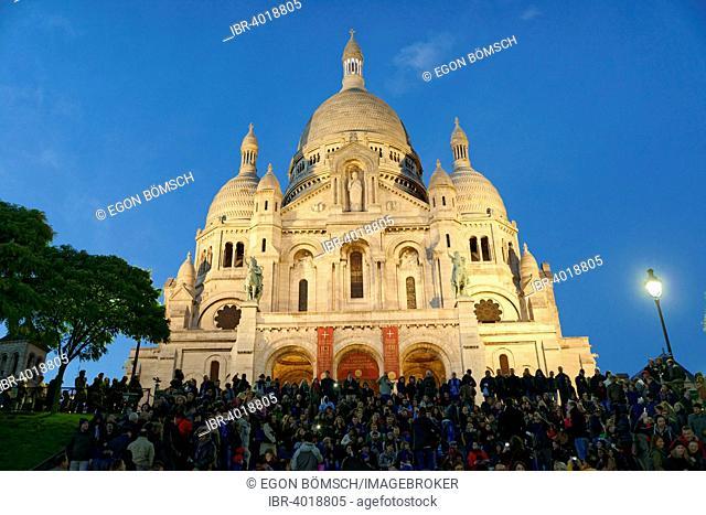 Sacré-Cœur basilica on Montmartre hill at dusk, Paris, France