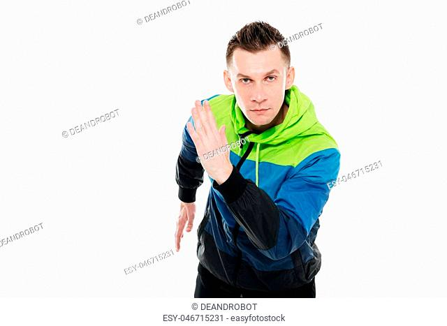Image of concentrated strong sportsman running isolated over white background. Looking at camera