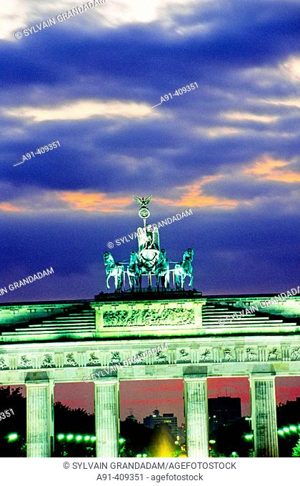 Brandenburg gate at dusk, elevated view . The iconic berliner monument was built in 1794 by the architect Langhans and the top bronze quadrige (four bronze...