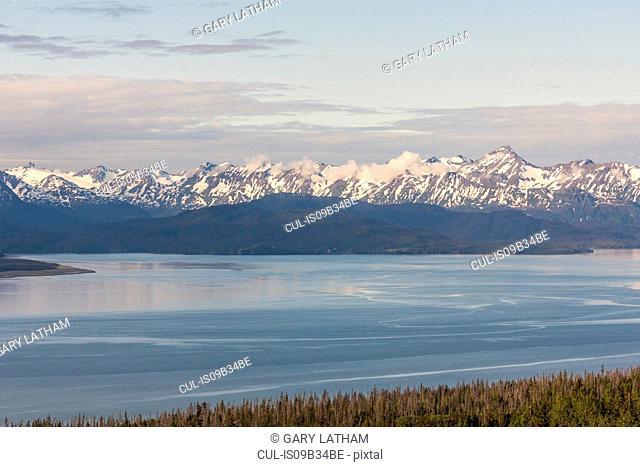 Snow capped mountains across water, Homer, Kachemak Bay, Alaska, USA