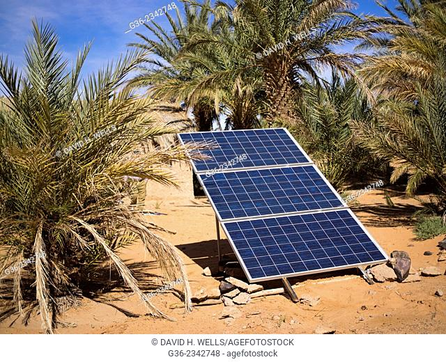 Solar panel on desert landscape in Tisserdmine Oasis, Morocco