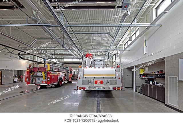 Fire Trucks in a Firehouse Bay
