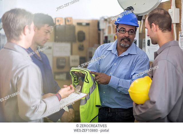 Instructor in a workshop showing safety vest