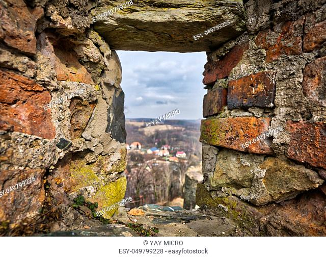 Window in the walls of the medieval Bolkow Castle in Lower Silesia, Poland