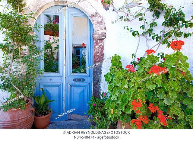 House with lots of foliage. Santorini. Greece