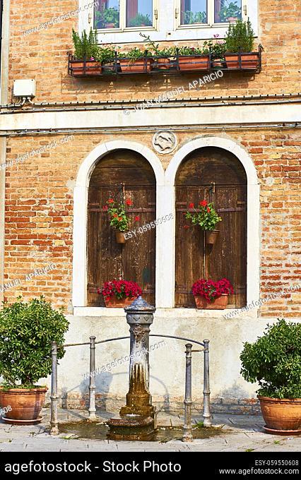 Detail of architecture and Iron Fountain in Murano, Venice, Veneto, Italy
