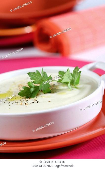 Bechamel sauce in white bowl