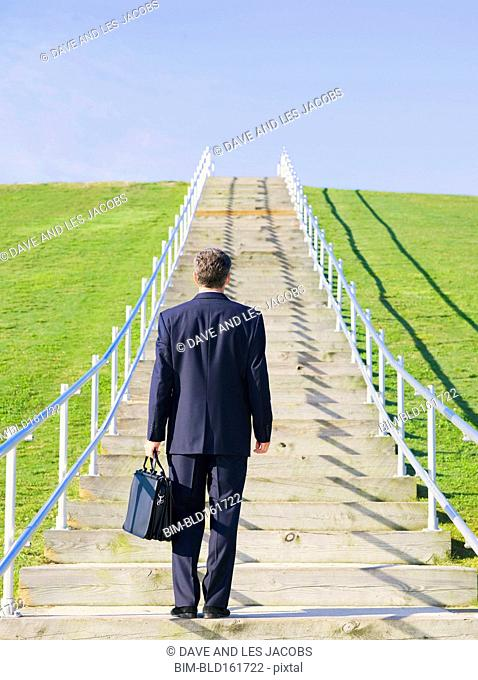 Caucasian businessman looking at outdoor staircase