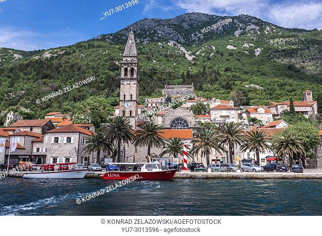 View from sea on Perast historical town with bell tower of Saint Nicholas church in the Bay of Kotor on the Adriatic Sea in Montenegro